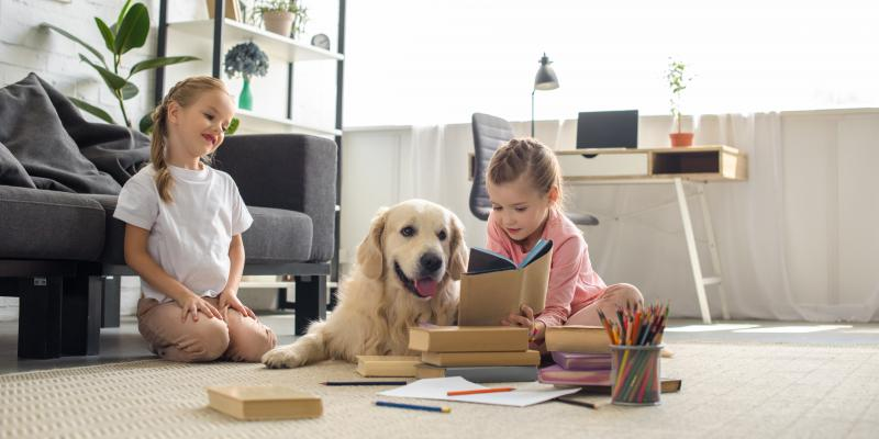 two girls and dog in pest-free home