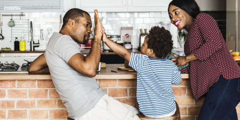 family hanging out in kitchen together